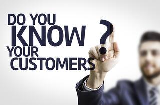 Business man pointing to transparent board with text Do you Know your Customers?.jpeg