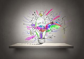Conceptual image of light bulb on wall with sketches of ideas.jpeg