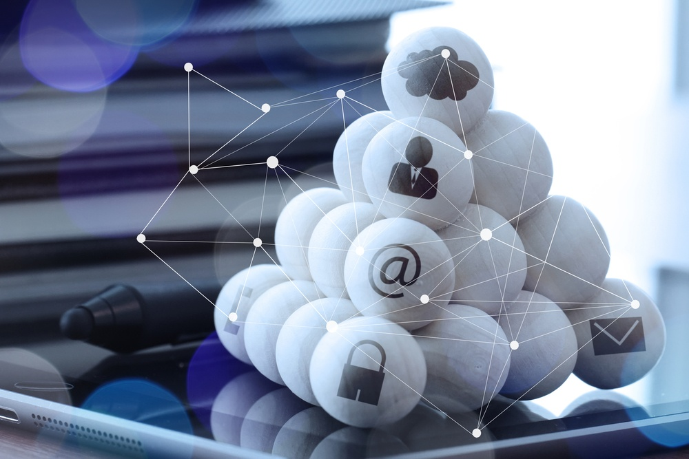wooden balls with technology icons and diagram media on computer as cloud network concept-1.jpeg